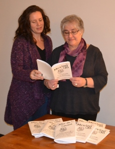 Photo:  Left-Right: Michelle Jay, Program Coordinator and Diane Kays, Chairperson of the PEI Advisory Council on the Status of Women review Moving On/Aller de l'avant, the revised and updated 2013 edition of the Council publication.