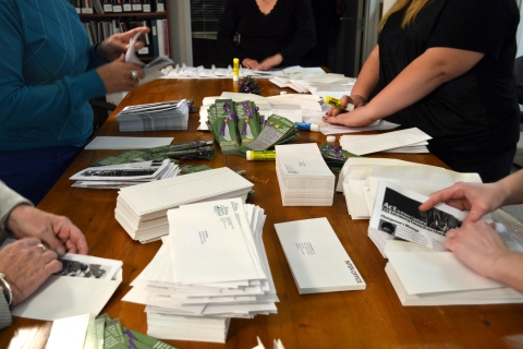 Many hands at work preparing the mailout.
