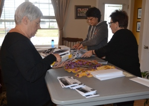Volunteers helping with the annual Purple Ribbon Campaign mailout. Thanks to Pat, Kate, Karen, and Dan (missing from photo).